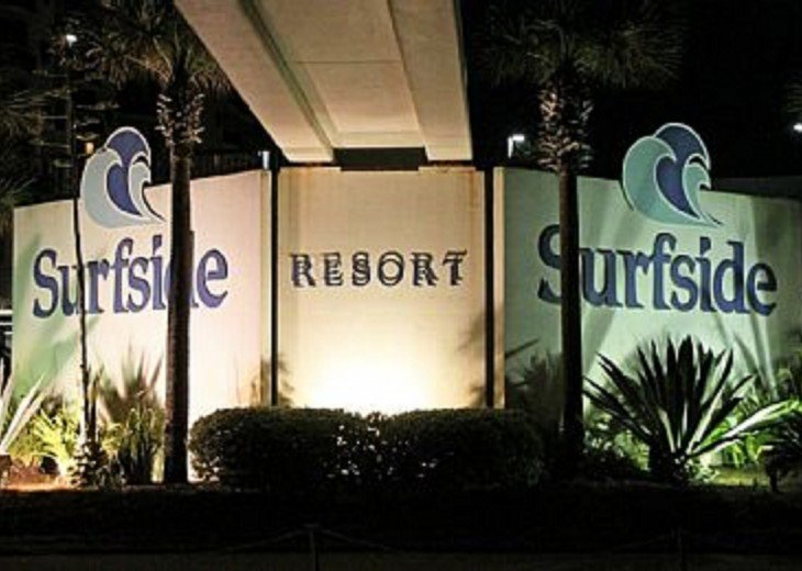 Surfside Resort sign at night