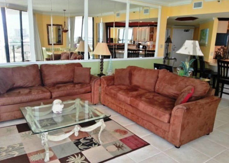 2 Large sofa's one being a queen sizes sleeper sofa with patio access