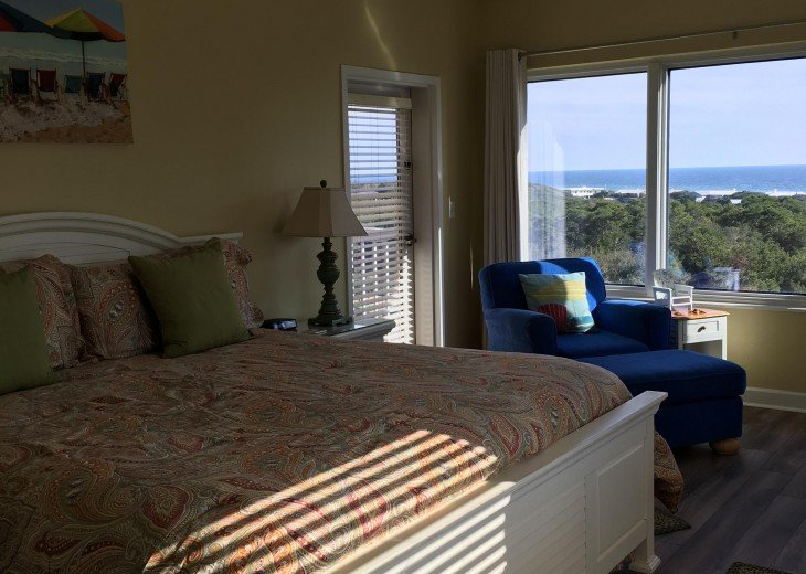 Master bedroom with balcony access and two views of the Emerald Coast