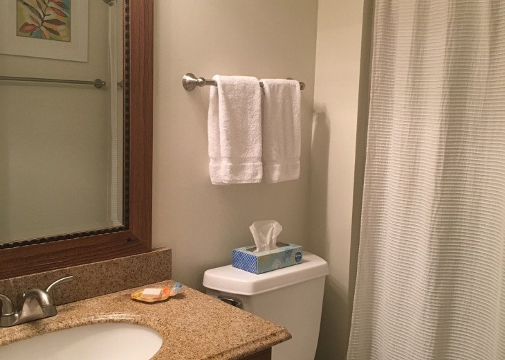Full guest bath furnished with towels and start up toiletries