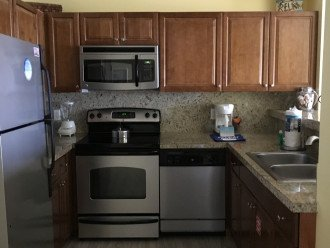 Kitchen with granite counters, stainless appliances and washer/dryer