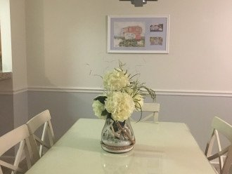 Dining room with dinnerware and seating for 8