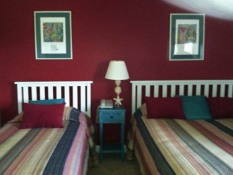 Guest bedroom has queen and twin beds to accommodate 2 couples and more