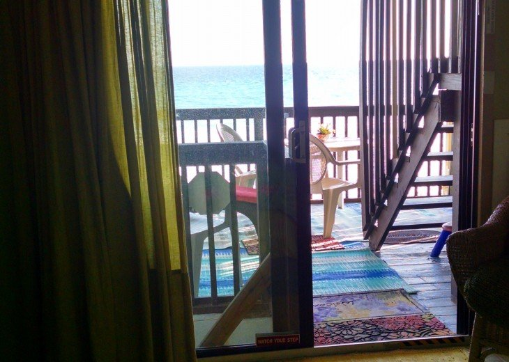 Ground floor apt. beach deck w/steps down to the sand deck and out to the Gulf
