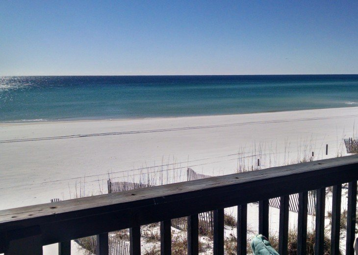 Sea oats below 3 decks over the beach; each deck w/chaise, DR table, chairs;