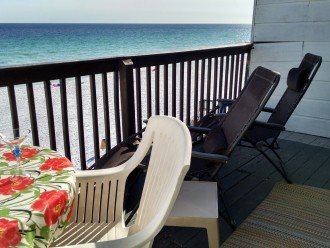 MBR deck over beach w/chaise, dining table, umbrella, drinks table