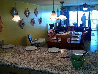 Granite bar w/setting for 4; DR table w/chairs for 8; high chair; view to beach