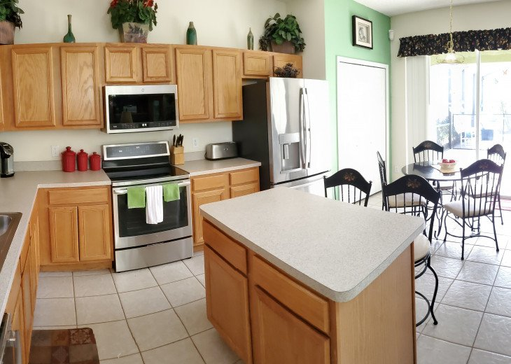 Kitchen with Stainless Steel Refrigerator, Stove, Microwave and Dishwasher