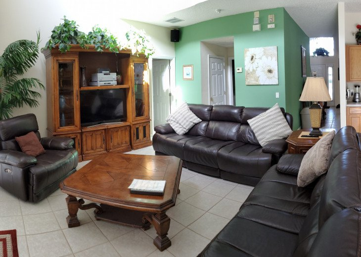 Family Room Couches, Recliner and Big Screen TV