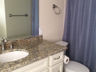 Master Bath includes two sinks, toilet, shower
