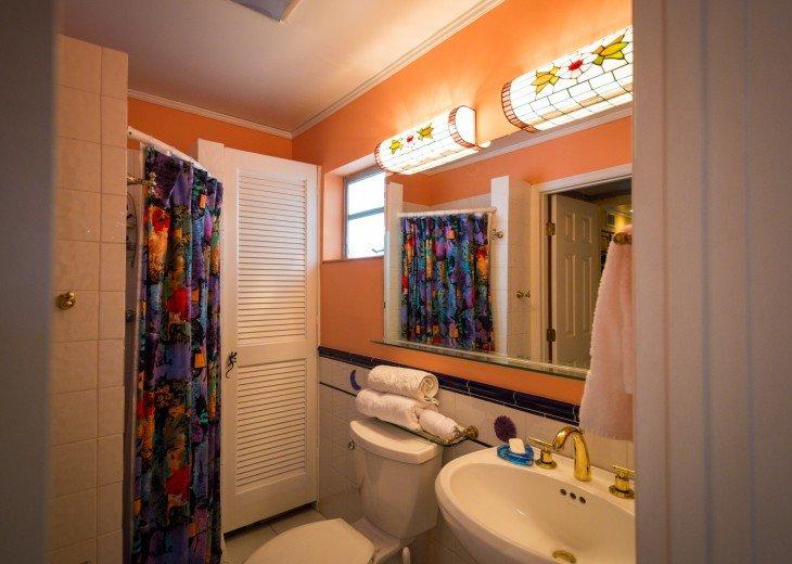 Second bathroom has shower and linen closet.