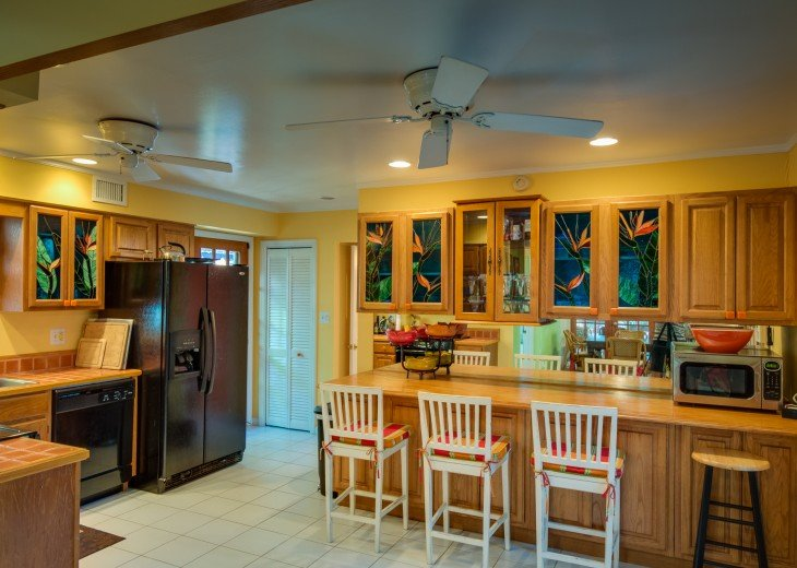 The colorful Key West kitchen is fully stocked has all the modern conveniences.