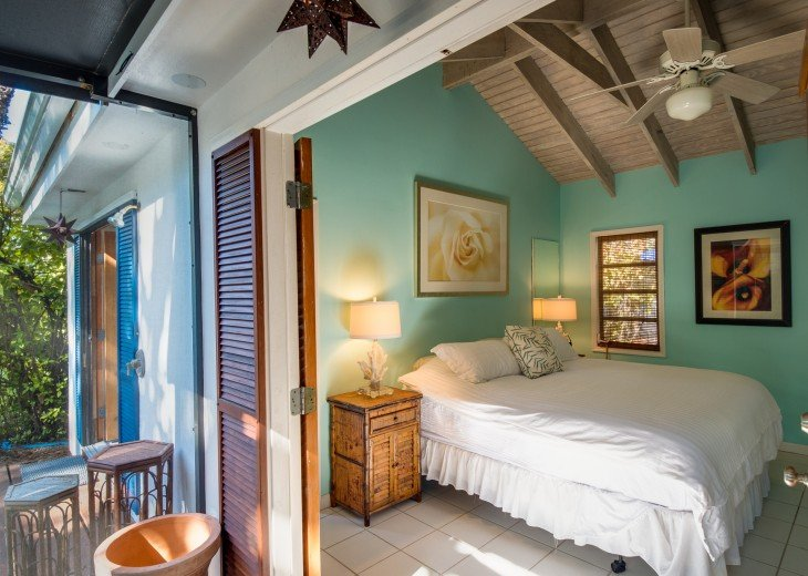 Master bedroom opens with view to the pool and private screened in porch.