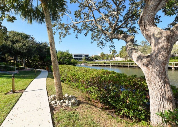 Walk way behind condo next to the water and docks