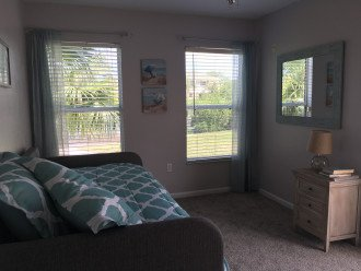 bedroom #5 with large twin daybed and access to pool area