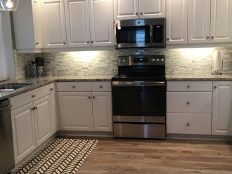 large kitchen with brand new granite countertops and stainless appliances