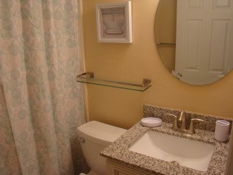 Renovated full guest bathroom with new fixtures.