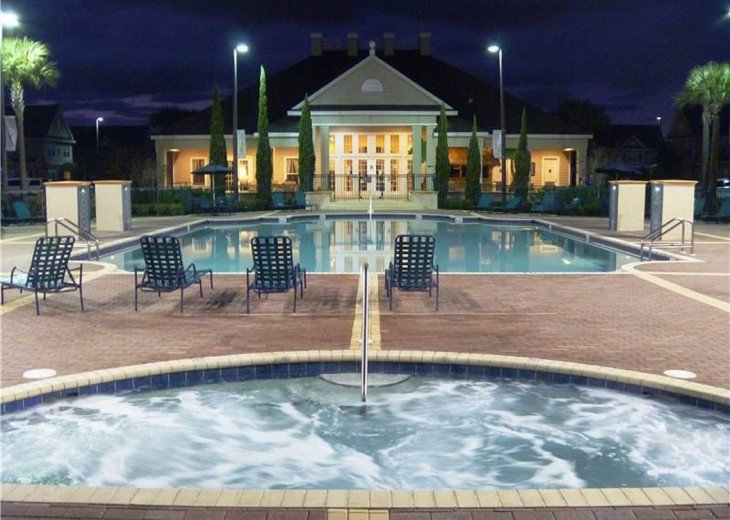 The Pool and Jacuzzi At night overlooking The Clubhouse.