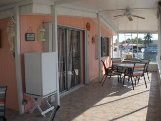 Screened patio with outside fridge and patio table