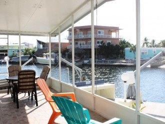 Relax in our wonderful screened patio overlooking the water