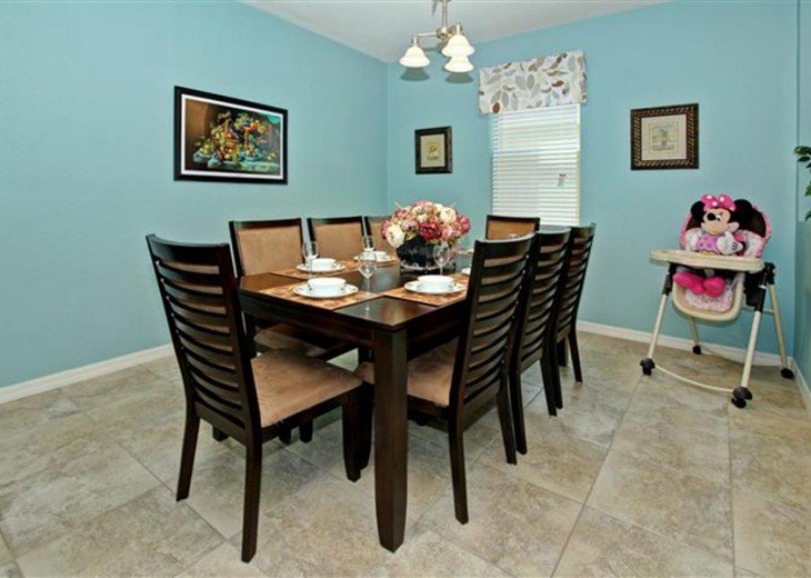 Dinner table with 8 seats and high chair