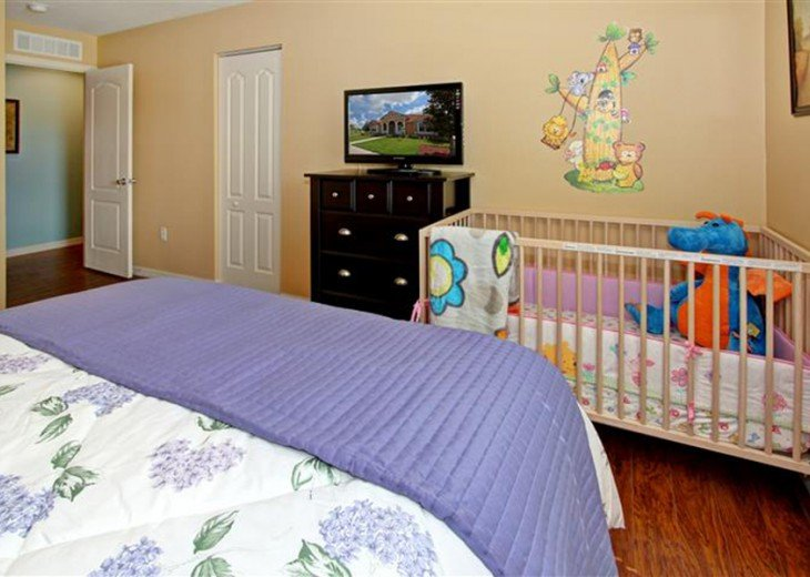 2nd floor queen bedroom with crib