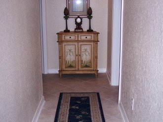 Hallway leads to 2 bedrooms and 2 bathrooms