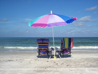 Relax......chairs, towels, umbrella provided