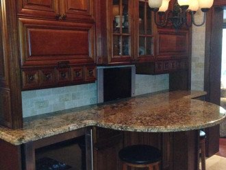 Flat screen TV and beverage cooler in kitchen