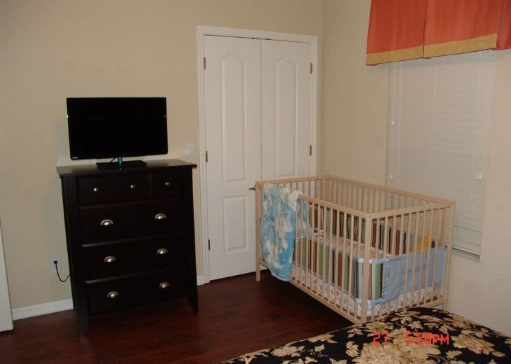 the crib in master bedroom on first floor