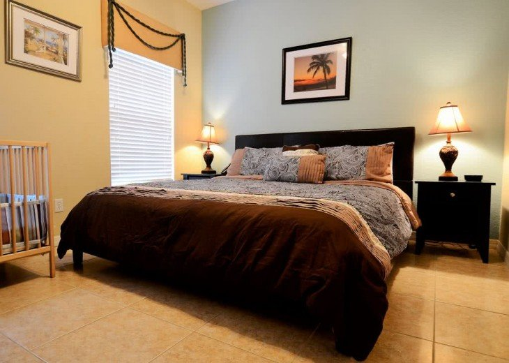 master suite with king bed and inside bathroom on first floor