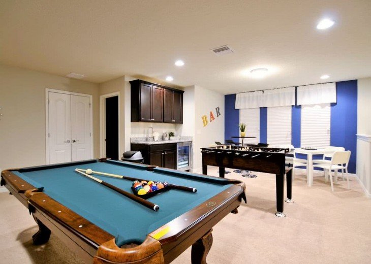 Pool table, foosball table and wet bar with seating for 8