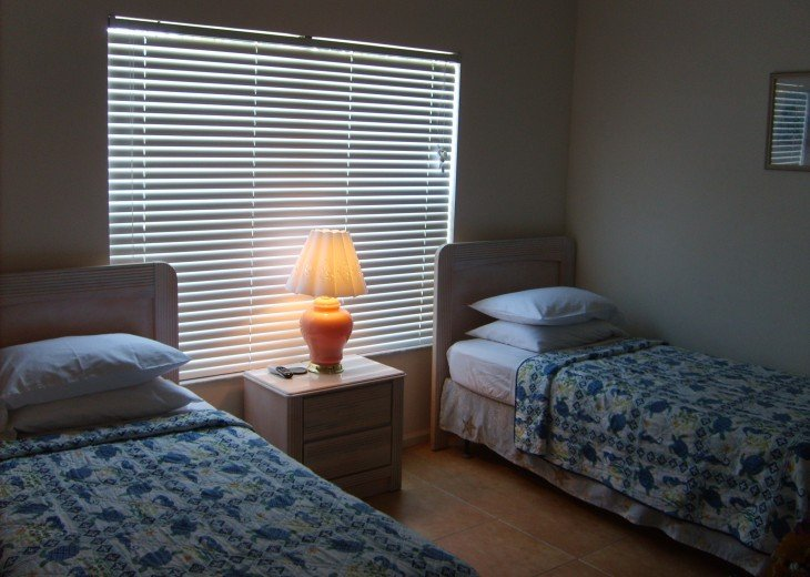 two twin beds with a private full bathroom, flat screen TV and free wi fi