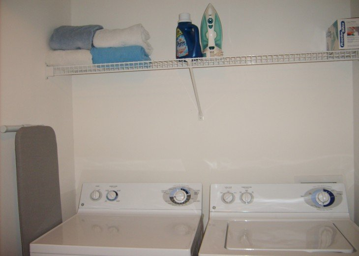 Full-size washer and dryer, complimentary detergent, iron and iron board