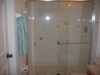 First floor bathroom has a walk in shower ,towels, extra toilet paper