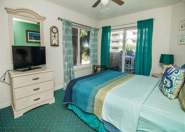 2nd bedroom with slider door to balcony with ocean view