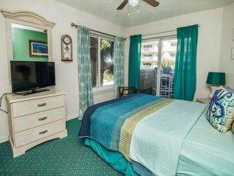 2nd bedroom with slider door to balcony with ocean view