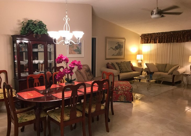 Cathedral ceilings in large open concept Living and Dining room seats 8