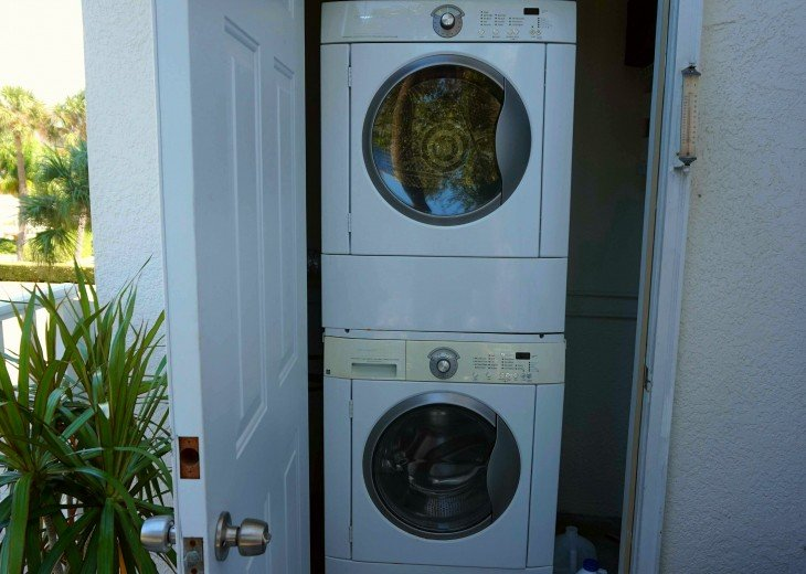 Stacked washer and dryer in condo