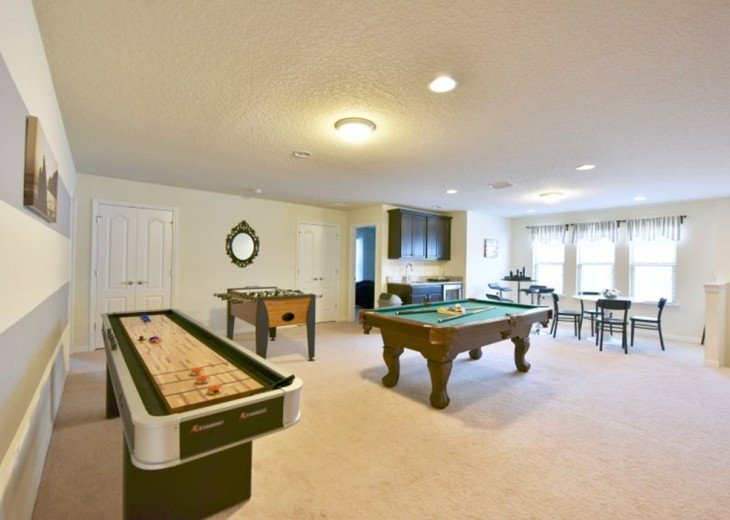 Curling table,Pool table, foosball table and wet bar with seating for 8.