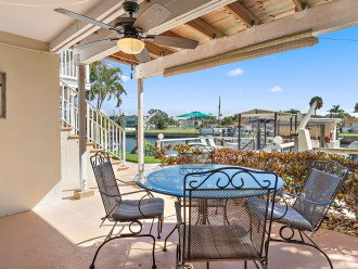 Sit waterside at your covered back deck area and watch boats and dolphins.
