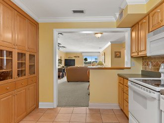 Open floor plan and custom cabinetry.