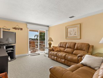 Plush leather furniture and wall mounted flat screen TV for relaxing.