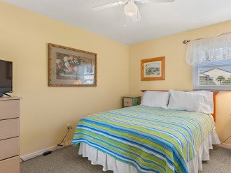 The second bedroom has a comfortable queen bed, flat screen TV and dresser.