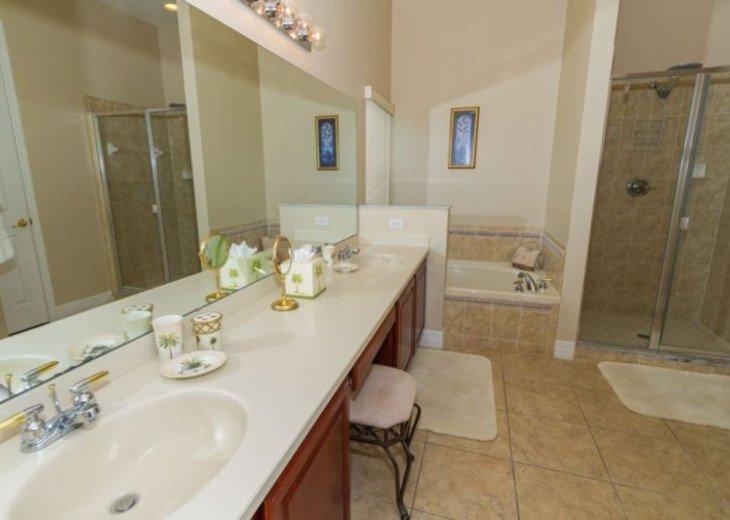 Master Bathroom 1 : Two washbasins, corner bath, walk in shower & WC
