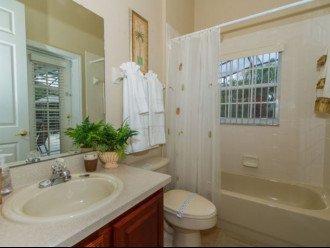 Bathroom 3: Washbasin, bath with overhead rainfall shower & WC