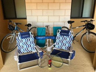 bikes, beach chairs, umbrella, tennis supplys