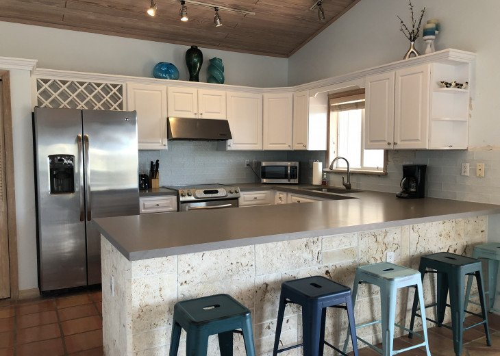 Gorgeous remodeled kitchen with quartz, tile and coral rock