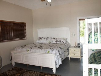 Downstairs bedroom with king bed and bunks