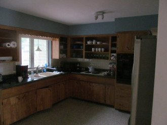 Full kitchen with microwave, stove and oven; coffee maker, fridge and blender